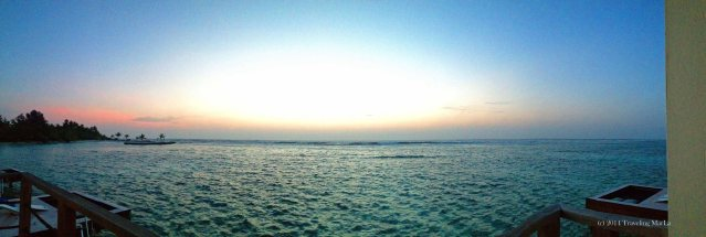 Panoramic view from our villa in the Maldives at sunrise.