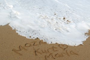 Mozambique sand writing poem