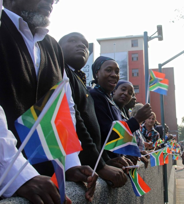 Society Culture SA flags at Mandela funeral